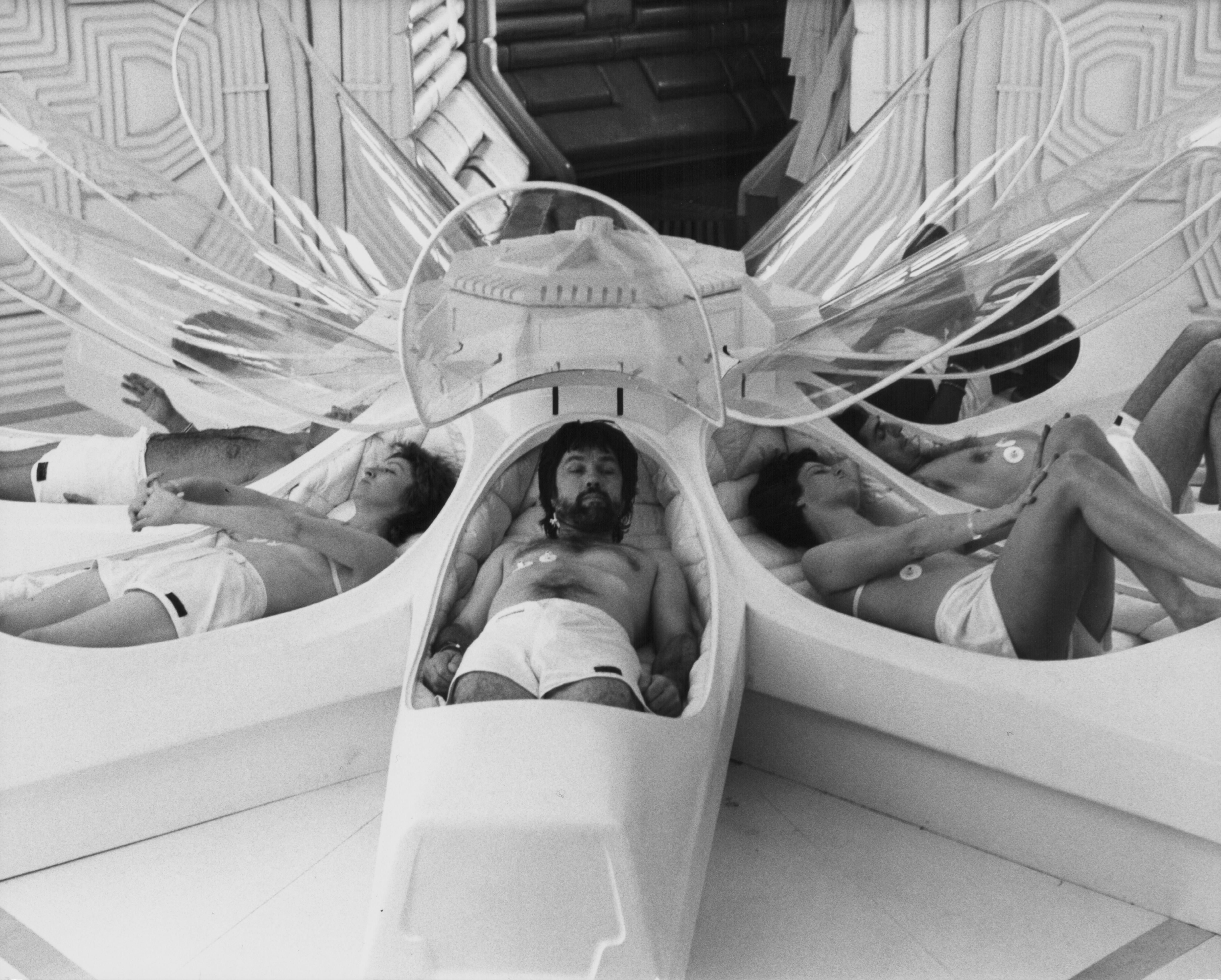 A scene from the movie Alien, in which the spaceship crew awakens from sleep pods.