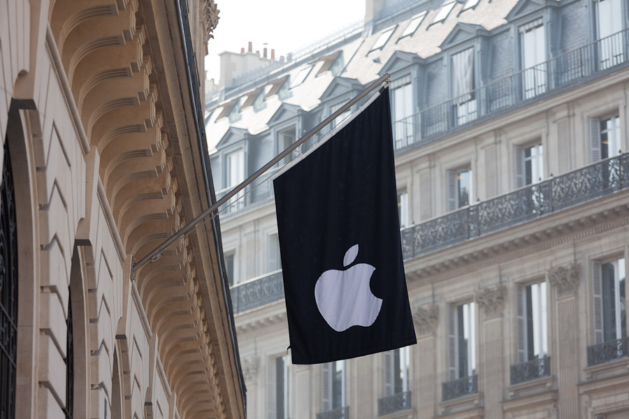 The Apple store in Paris sports the company logo on a flag.