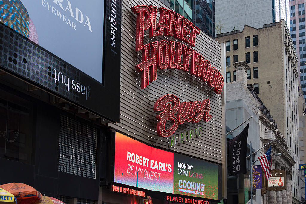 Planet Hollywood and other signs in Times Square.Planet