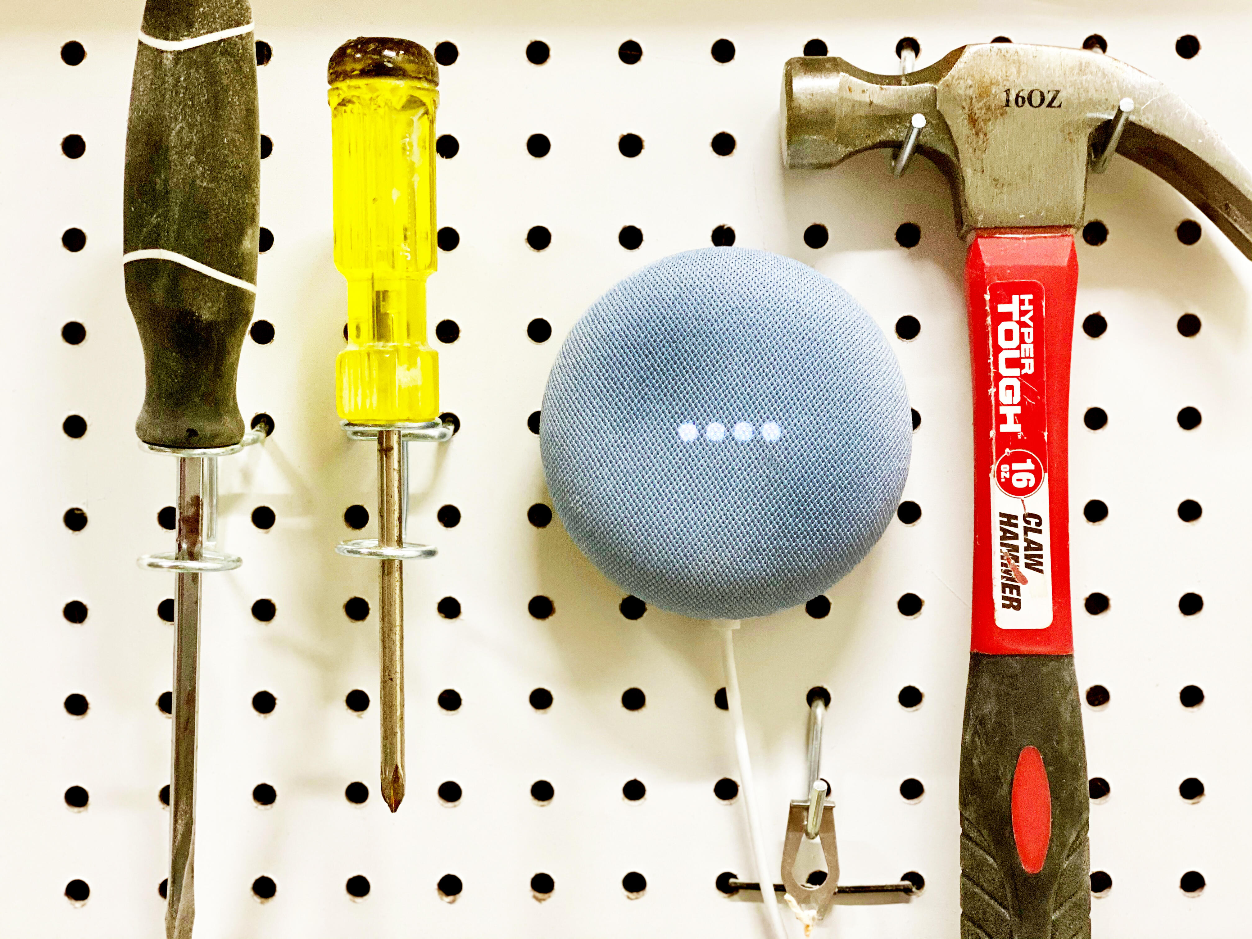 Google Home on pegboard with tools