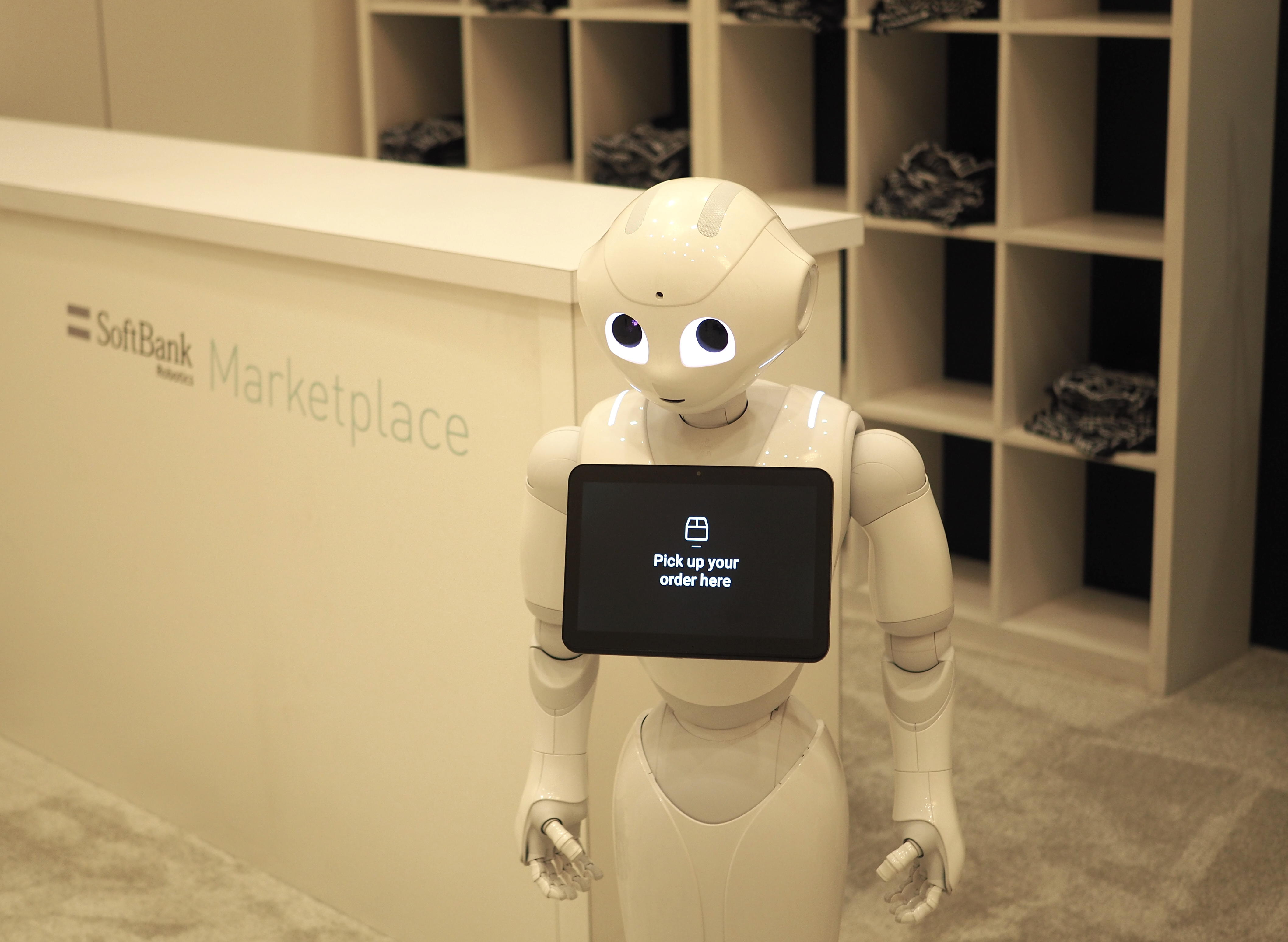 """Pepper the robot at Softbank's CES marketplace. A display on Pepper's chest reads """"Pick up your order here."""""""
