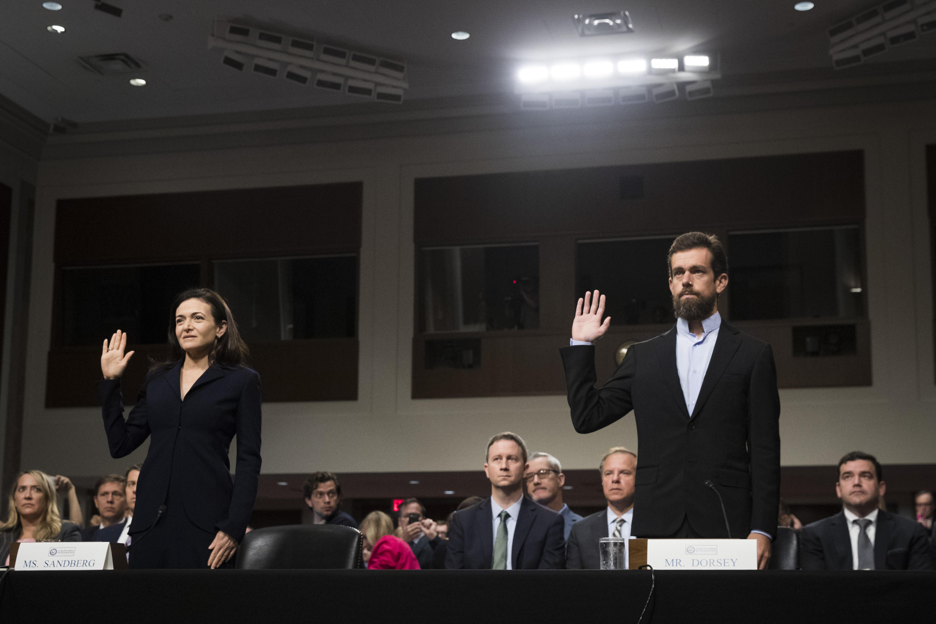 Facebook COO Sheryl Sandberg and Twitter CEO Jack Dorsey are sworn in at the start of the Senate intelligence committee hearing Wednesday.