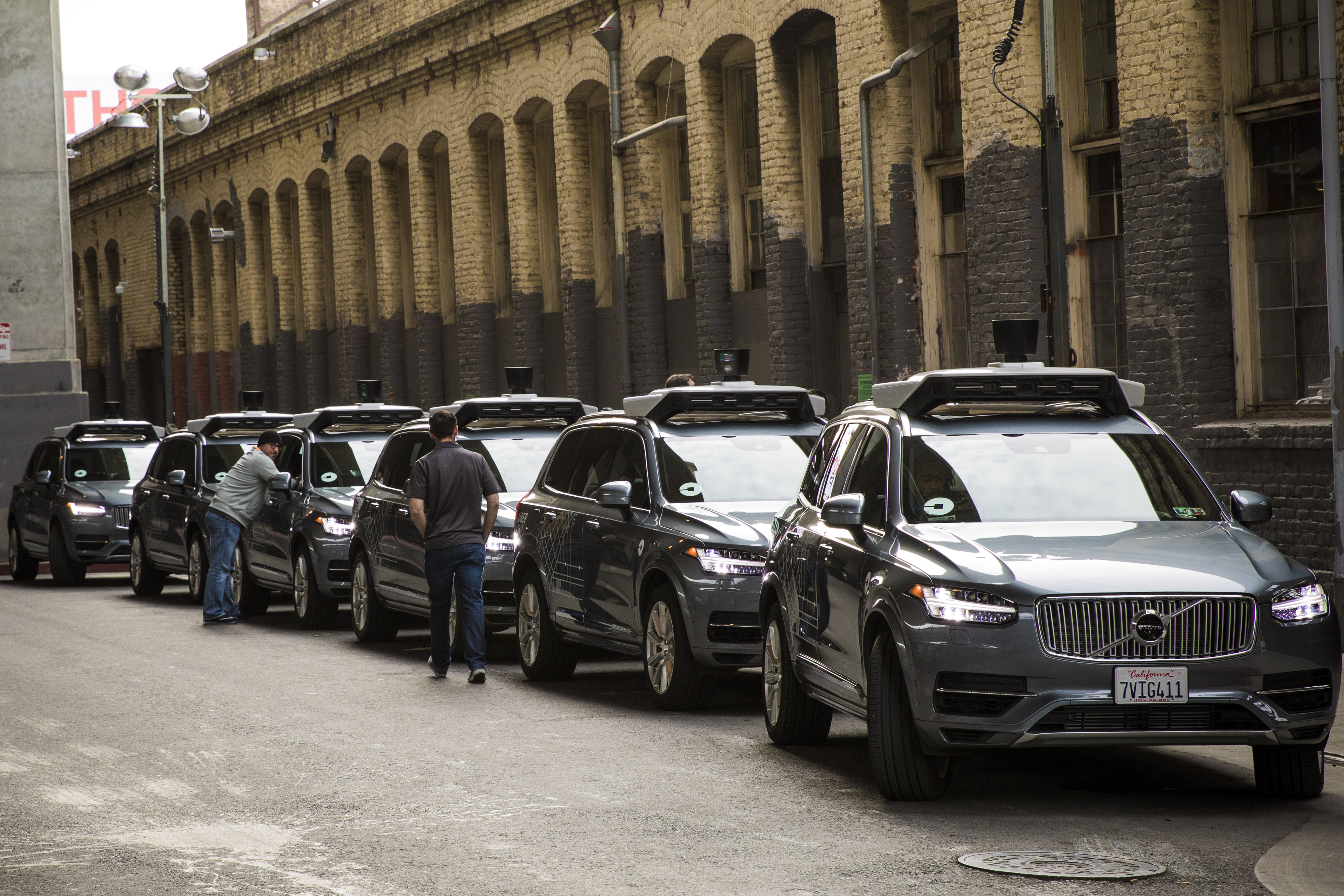 A line of Volvo XC90 crossover SUVs, modified by Uber to function as self-driving cars.