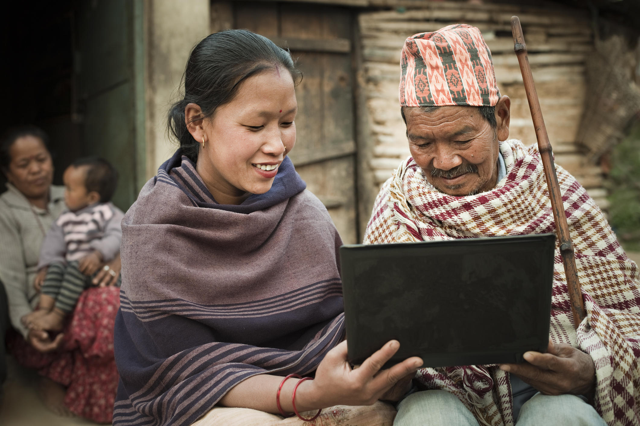Rural Asian young woman uses internet