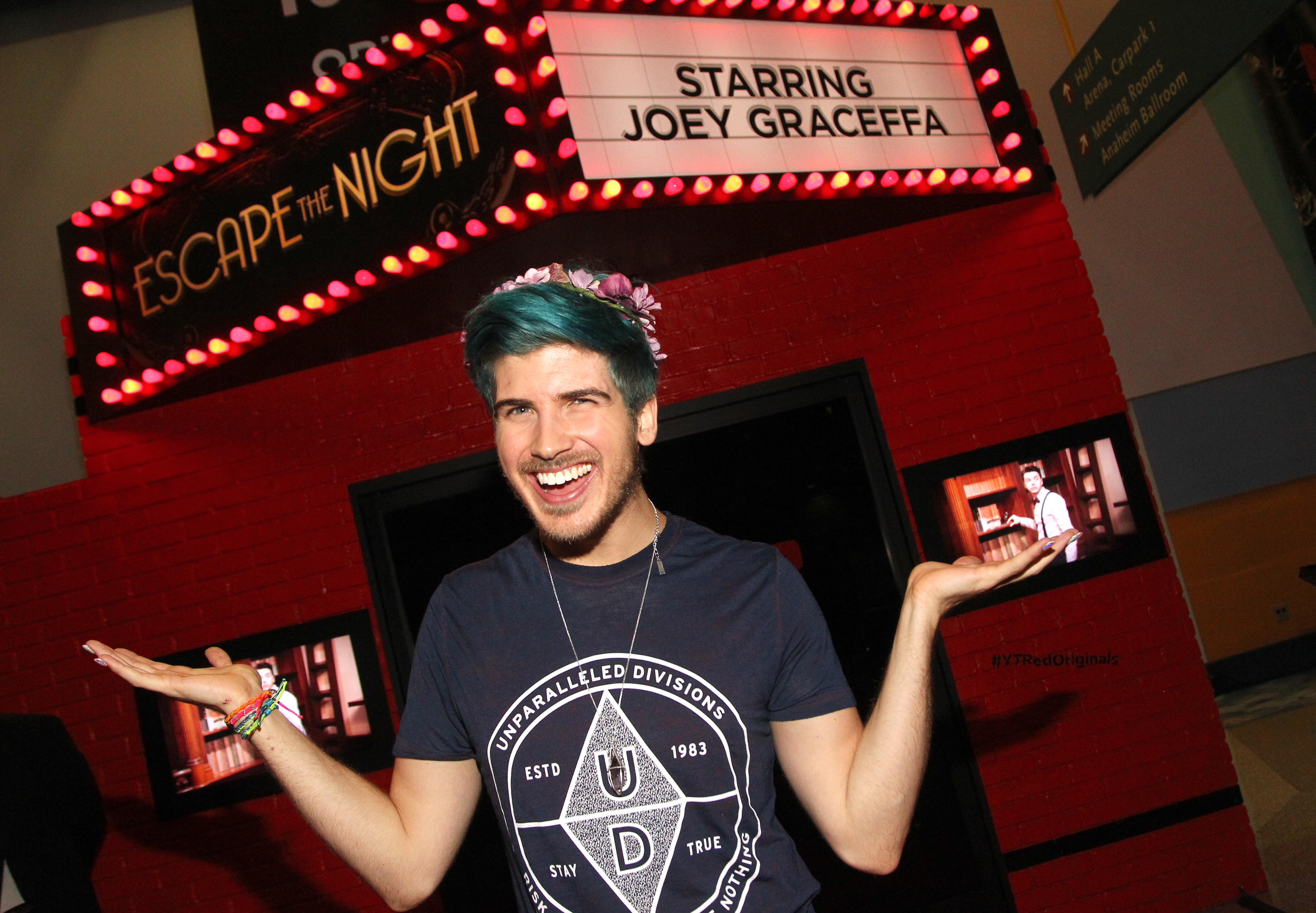 """YouTuber Joey Graceffa stands in front of a theater screening YouTube Red original """"Escape the Night"""""""