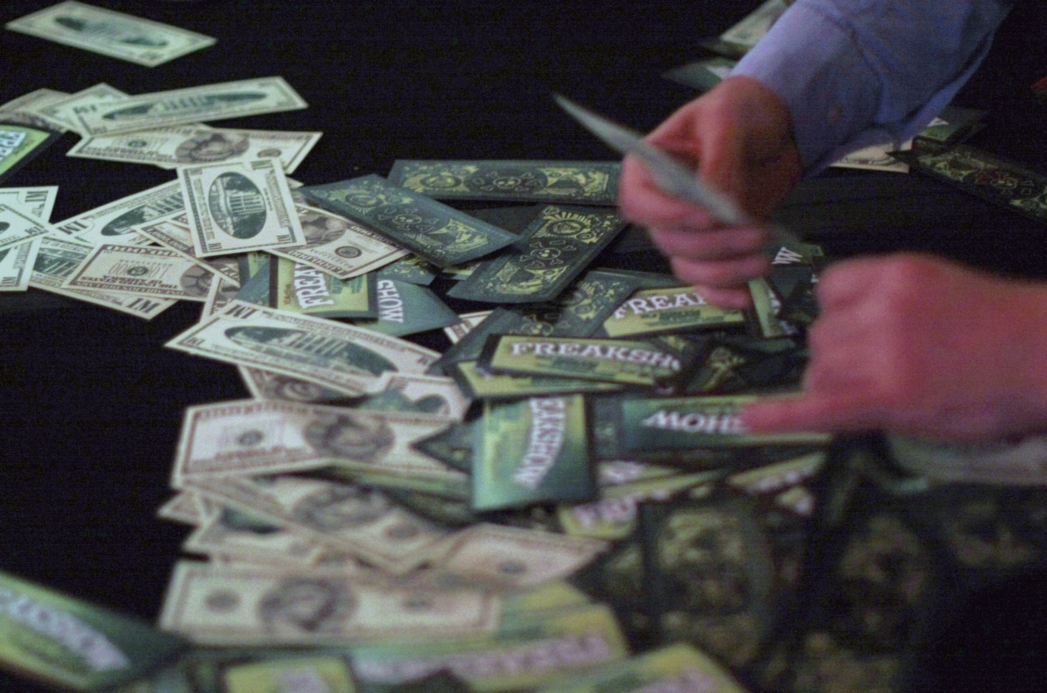 Black Hat 2010 attendees grab wads of fake money spewed out by an ATM machine hacked by Barnaby Jack.