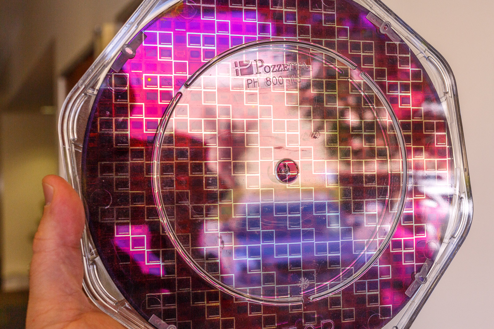 A circular wafer of InVisage image sensor chips reflects light -- but not as much, since the dots absorb light better than conventional silicon-based microchip sensors.