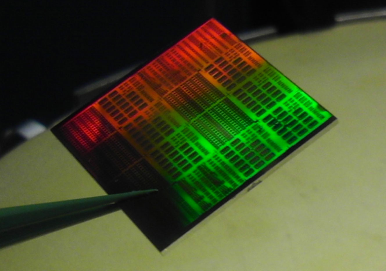 This photo shows a slice of silicon with an array of dozens of graphene-based receiver chips. The graphene was added during the final manufacturing stages, an approach that helped preserved the thin sheet of carbon atoms from harm.