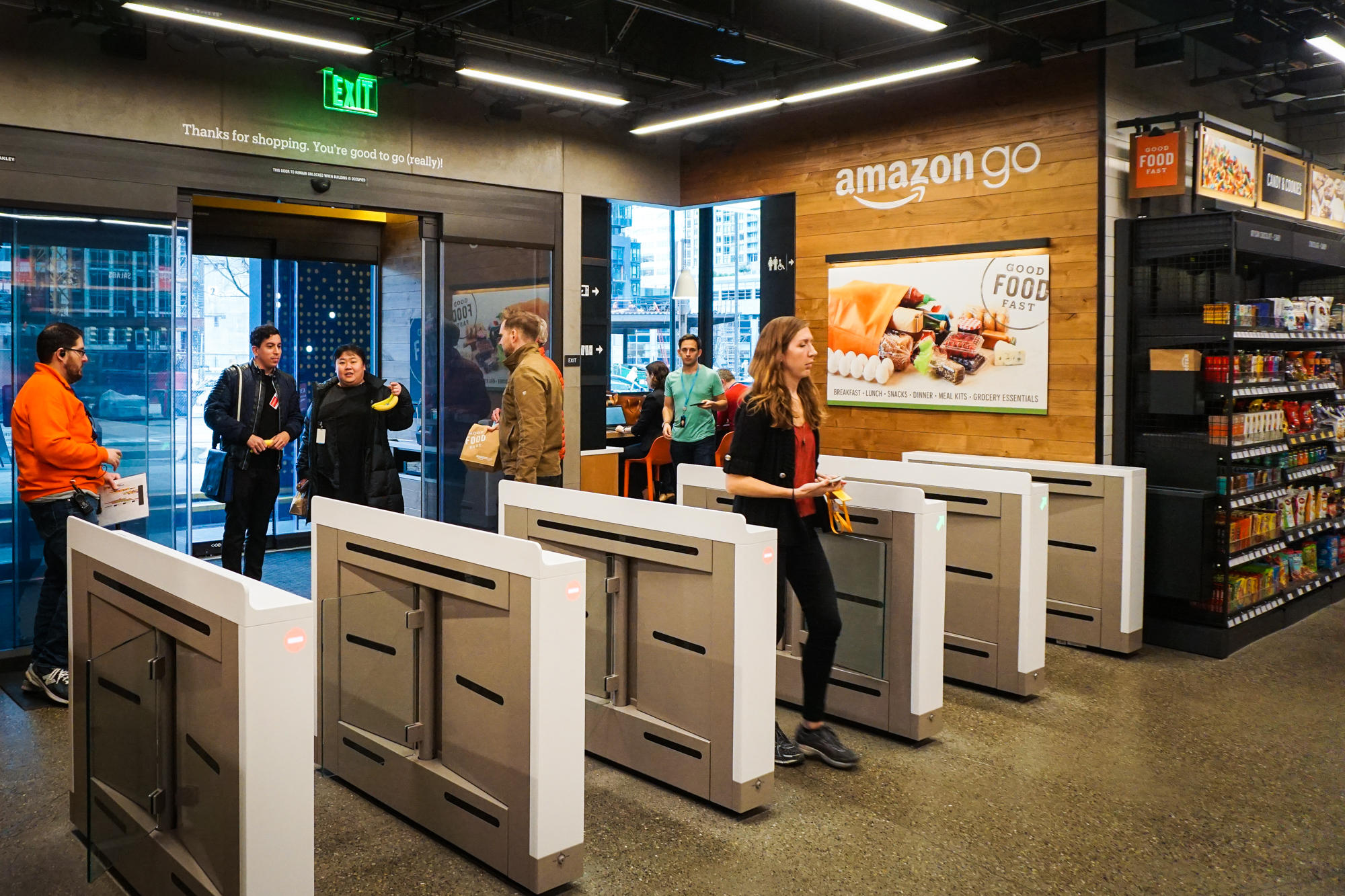 A customer enters the Amazon Go store.