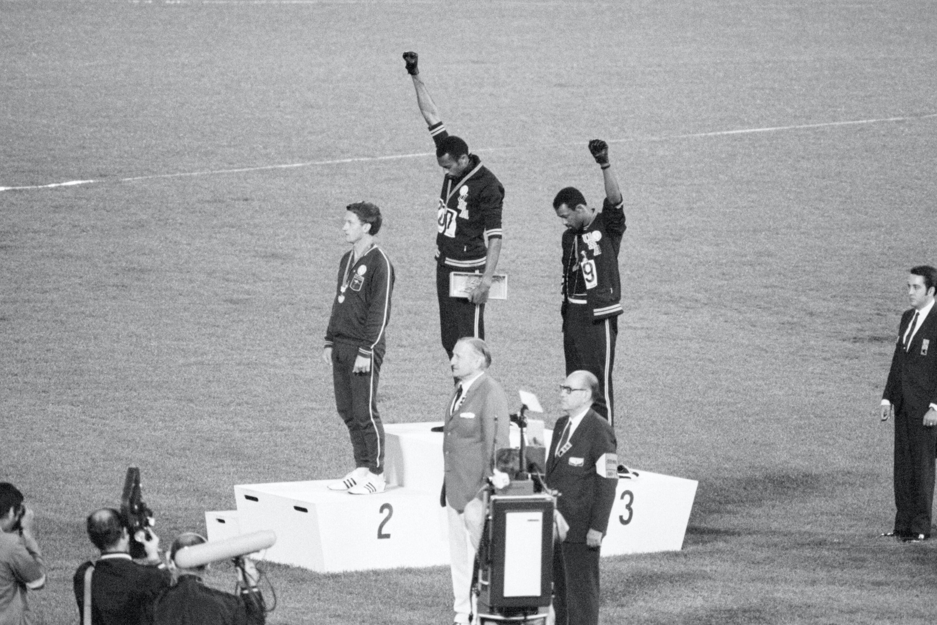 Tommie Smith and John Carlos with raised fists on the medal stand at the 1968 Summer Olympics