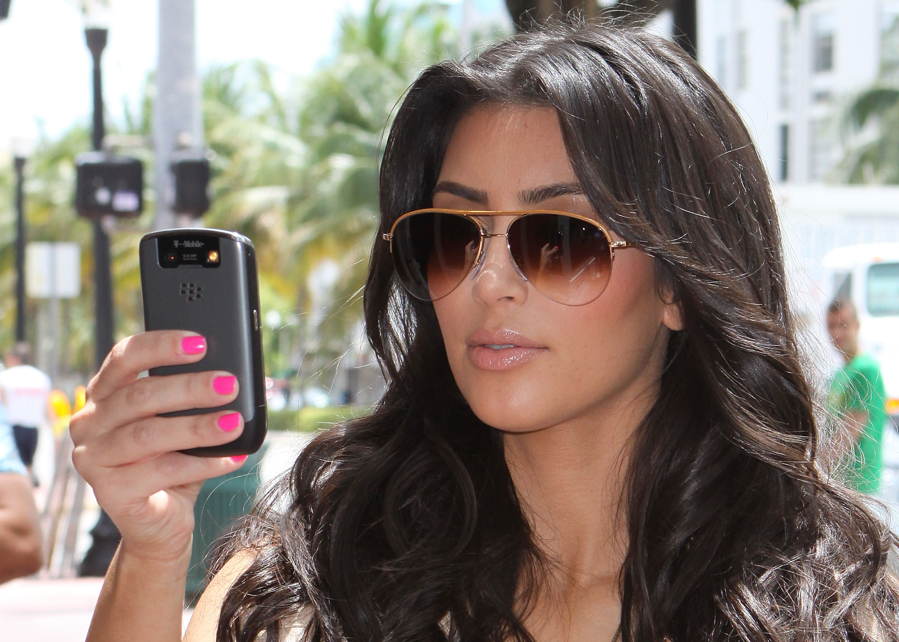 MIAMI BEACH, FL - MAY 19:  Television personality Kim Kardashian takes a picture of graffiti vandalism done to her new store on May 19, 2009 in Miami Beach, Florida.  (Photo by Mike Franklin/FilmMagic)