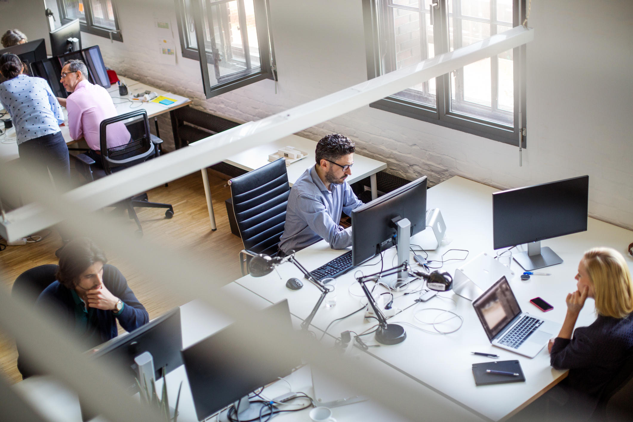 Programmers using computers at creative office