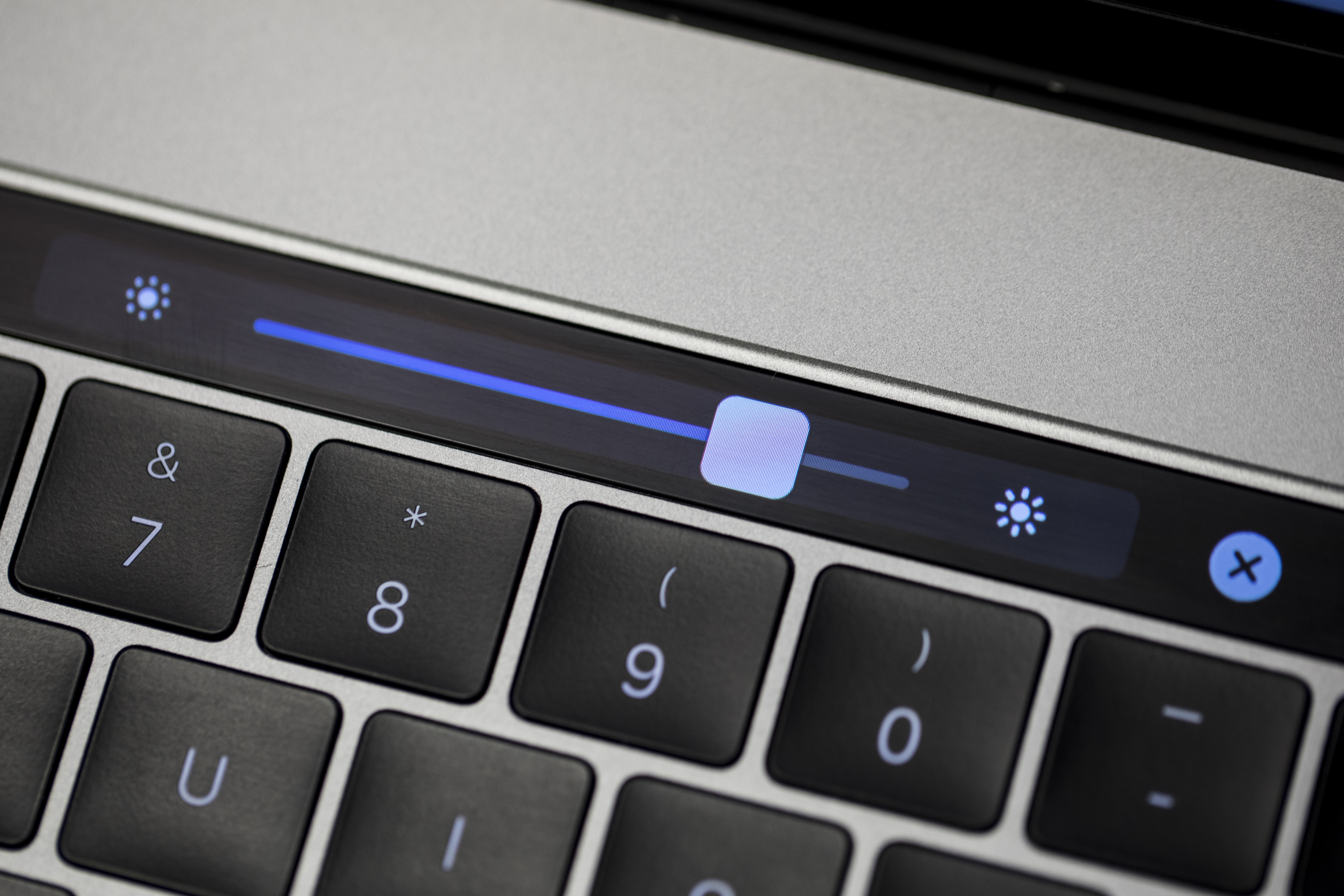 The 2016 MacBook Pro Touch Bar lets you dim the laptop's screen to save power.