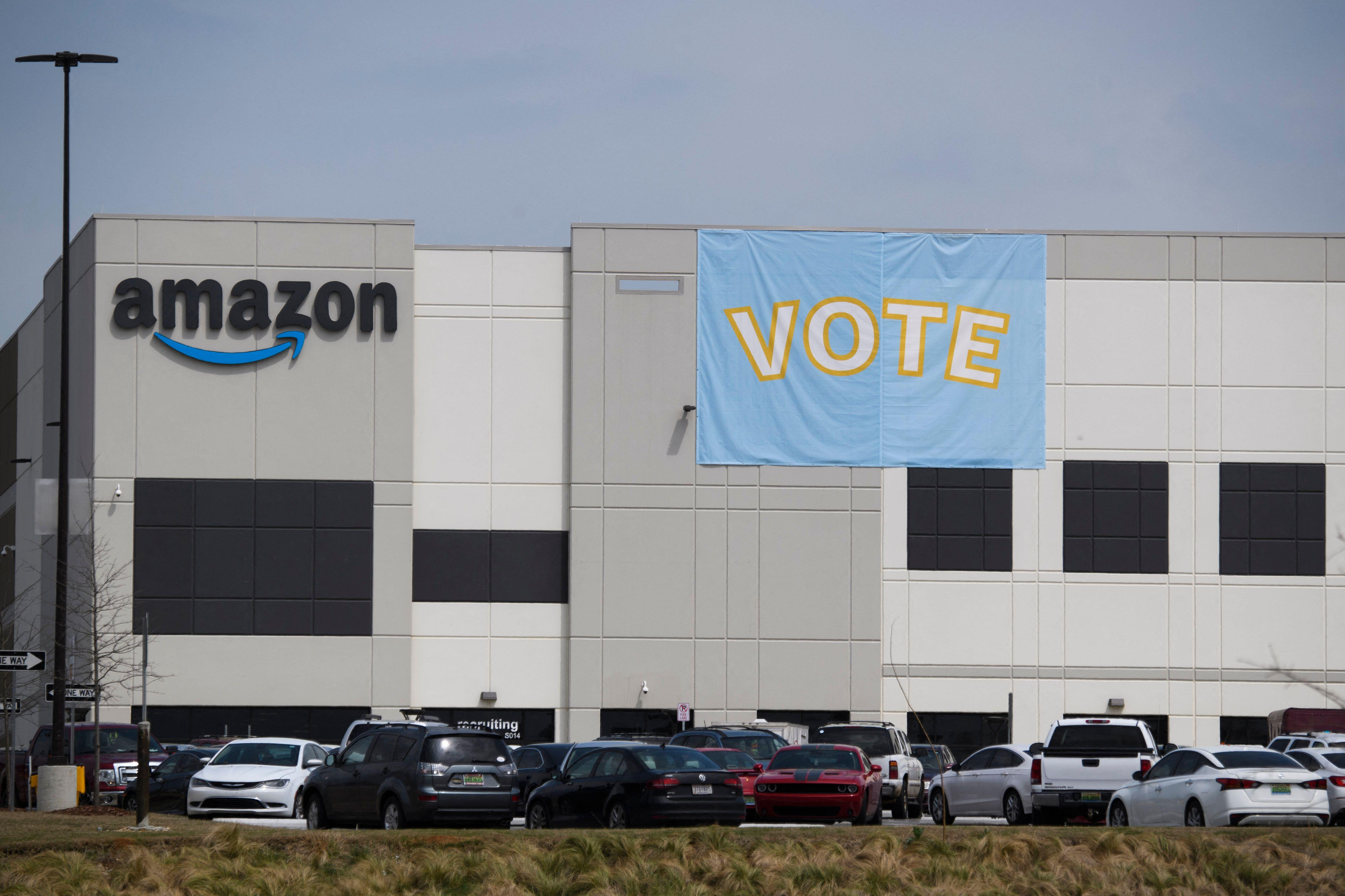 "Amazon warehouse in Bessemer, Alabama, with a ""vote"" banner hanging on the side of the building"