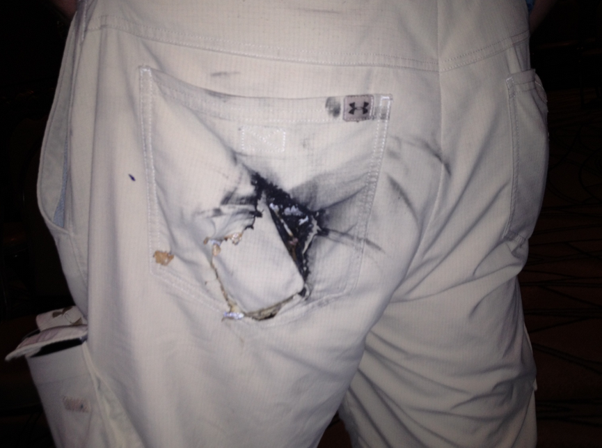 Defcon attendee shows CNET his charred backside after his cell phone battery spontaneously caught fire and seared a hole through his pants pocket.