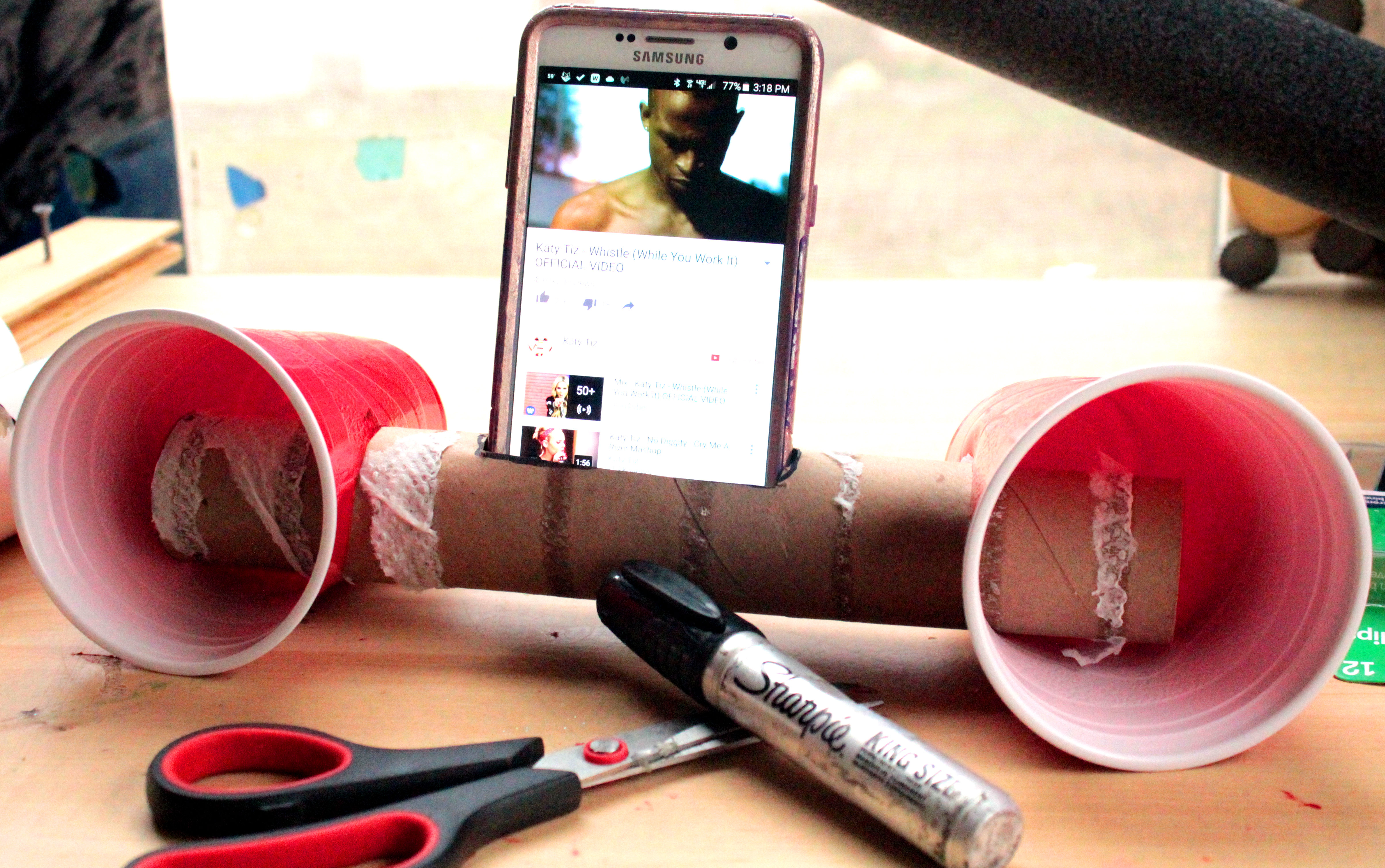 Plastic cups and a cardboard tube