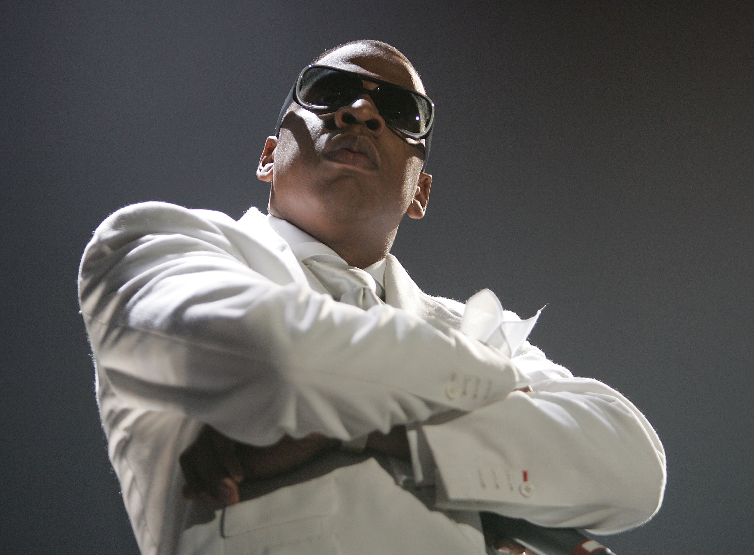 """ROSEMONT, ILL - SEPTEMBER 30: Rapper Jay-Z performs during the """"Best of Both Worlds"""" tour with R. Kelly, September 30, 2004 at the Allstate Arena in Rosemont, Ill. (Photo by Frank Micelotta/Getty Images)"""