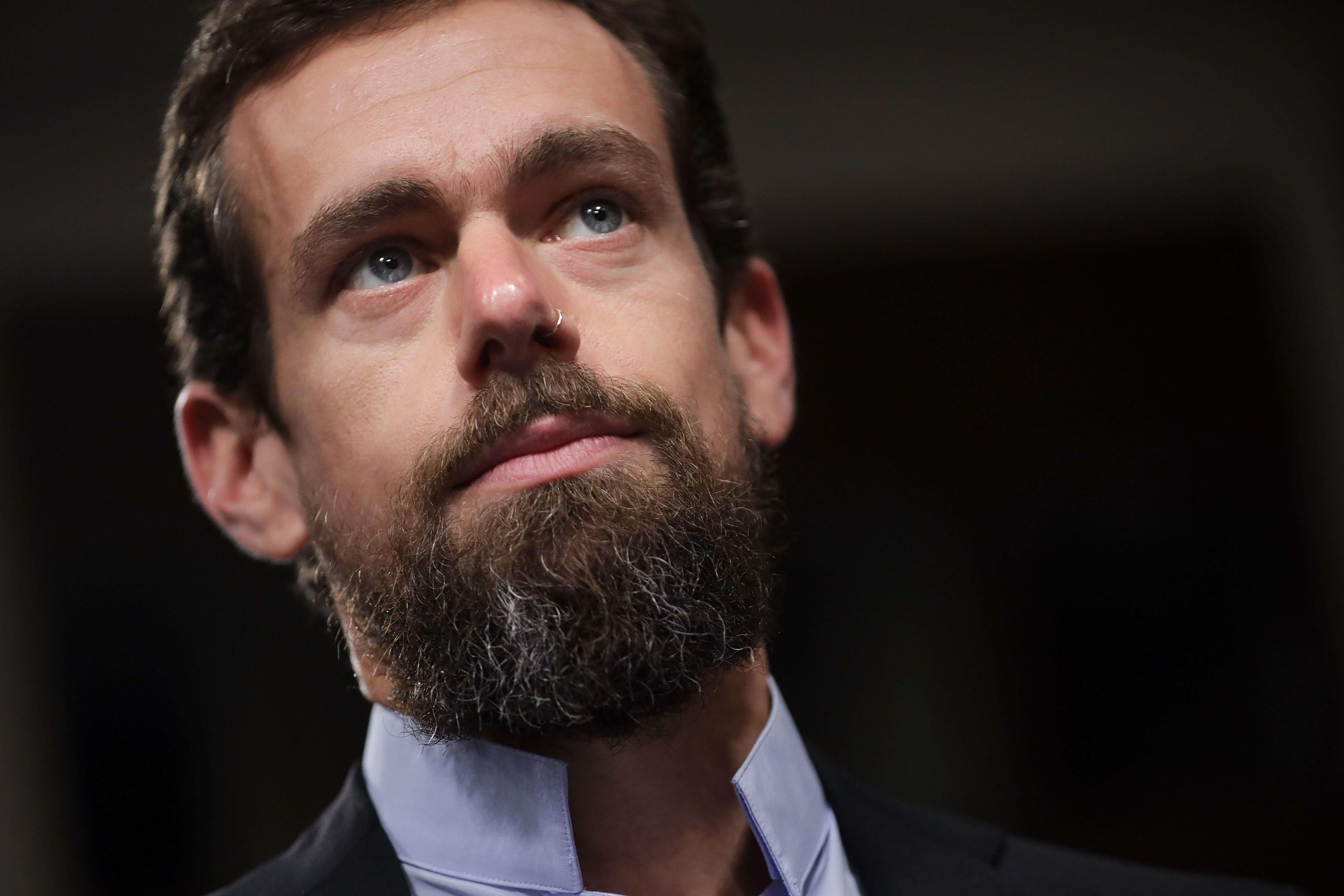 A tight shot of Twitter CEO Jack Dorsey's as he listens to senators
