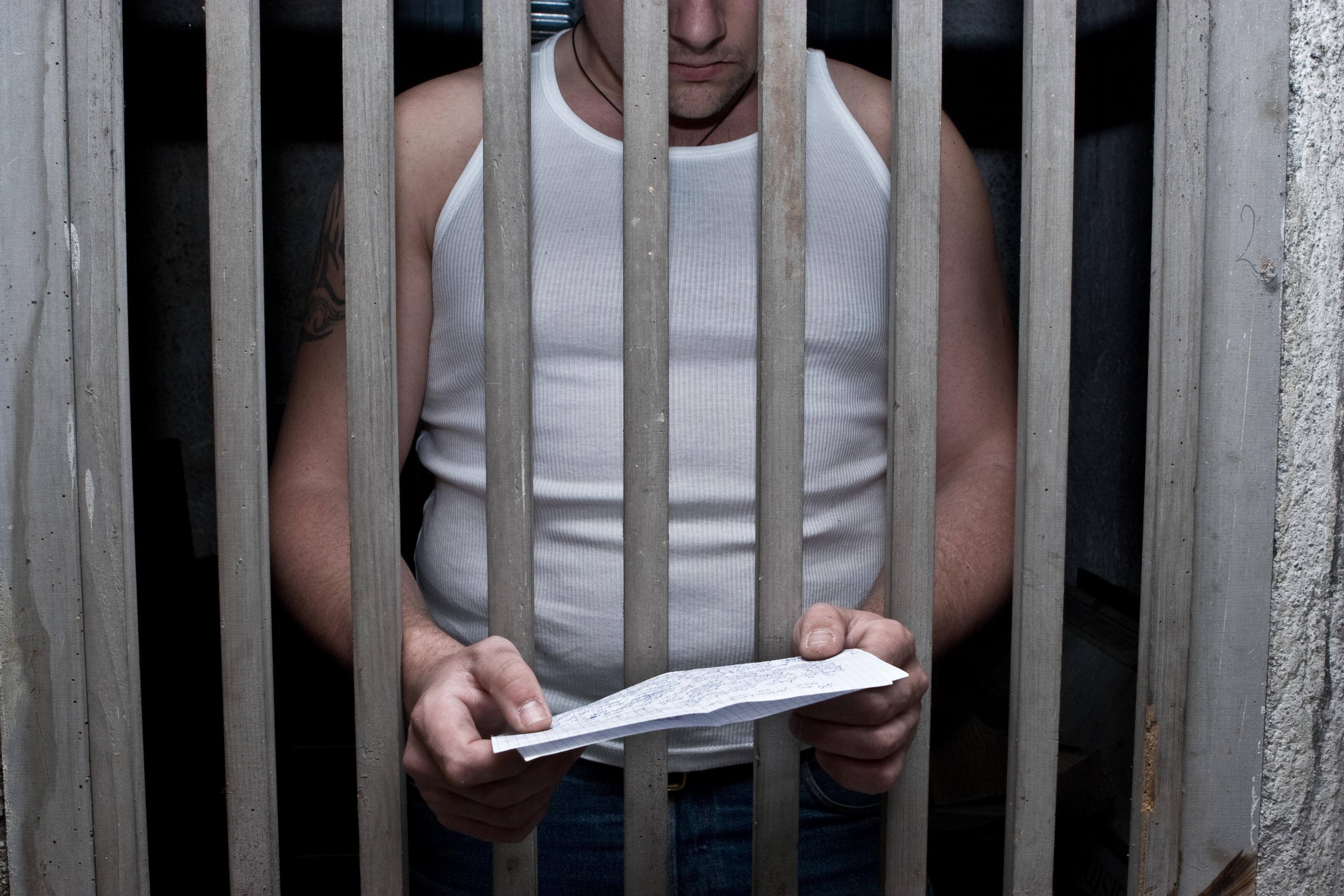 An inmate reads a letter.