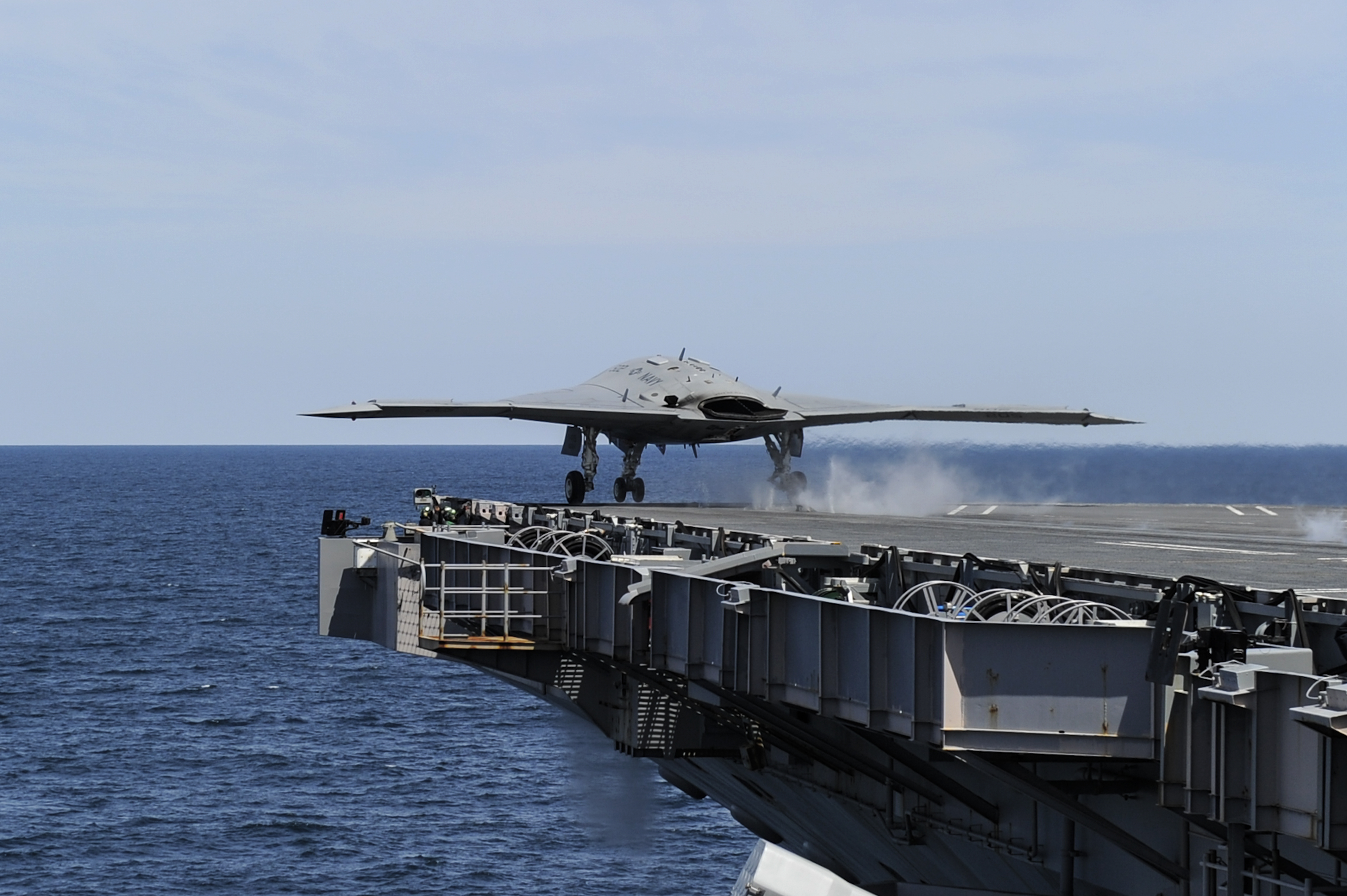 X-47B makes catapult launch from USS George H.W. Bush
