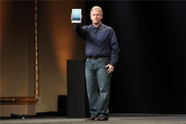 Apple executive Phil Schiller showing off the iPad Mini.
