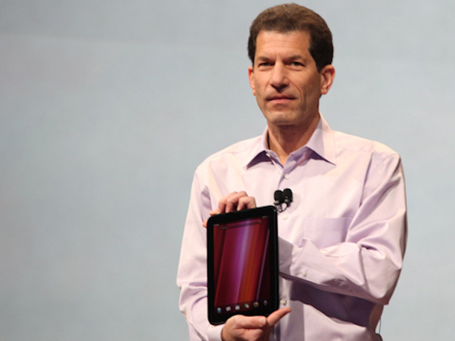HP's Jon Rubinstein holds the company's first WebOS tablet, the TouchPad.