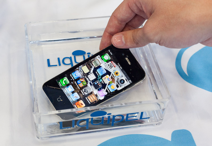 Liquipel showed an iPhone treated to survive full immersion in this tray of water at Mobile World Congress.