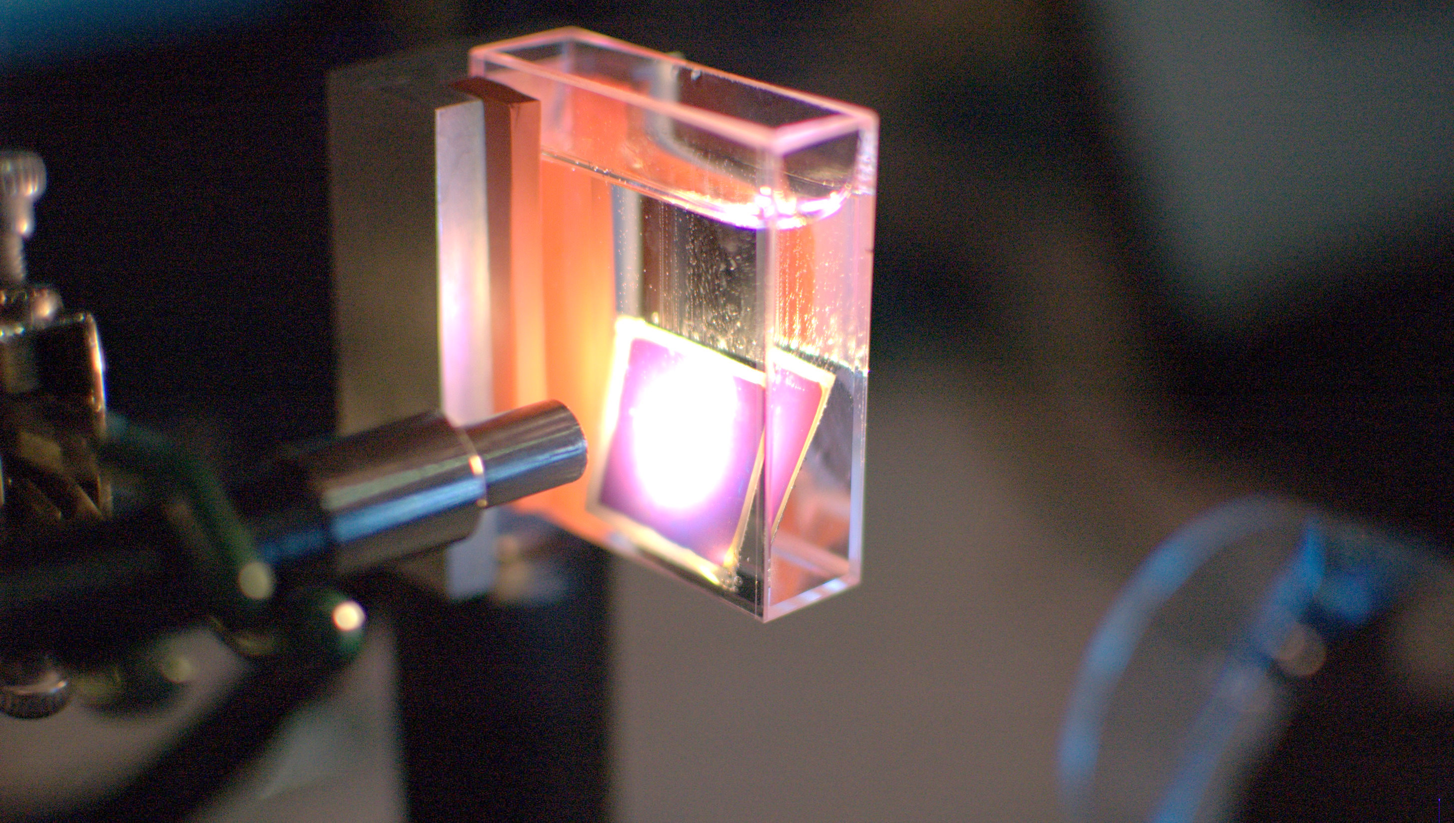 Making hydrogen gas (the bubbles) from a solar cell in water, a Sun Catalytix prototype.