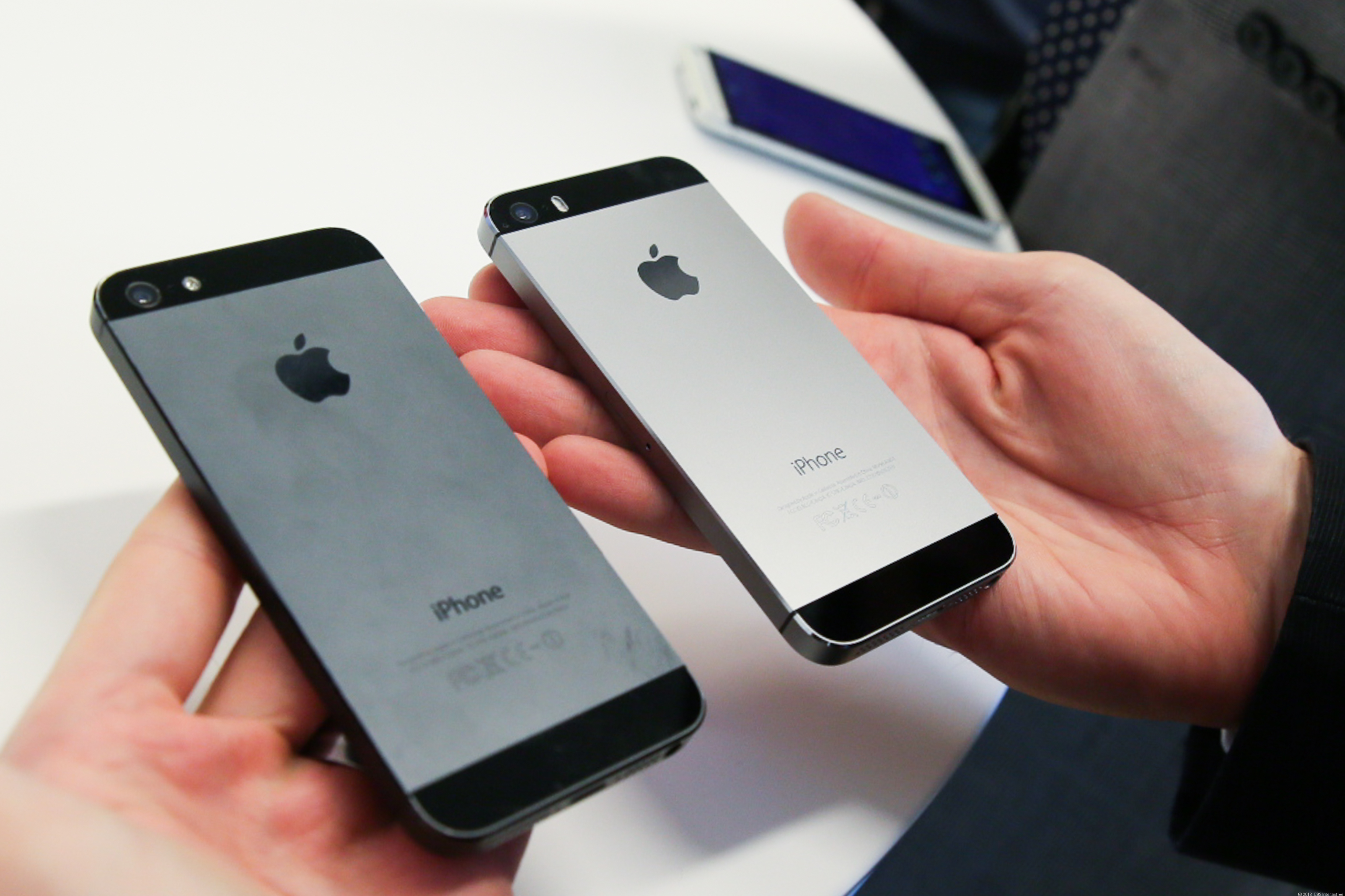 The iPhone 5, left, and 5S in space gray.