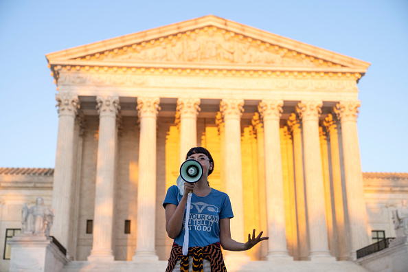 A protester outside the US Supreme Court after justices there declined to block the new Texas abortion law, instead letting the legal battle play out in the lower courts.