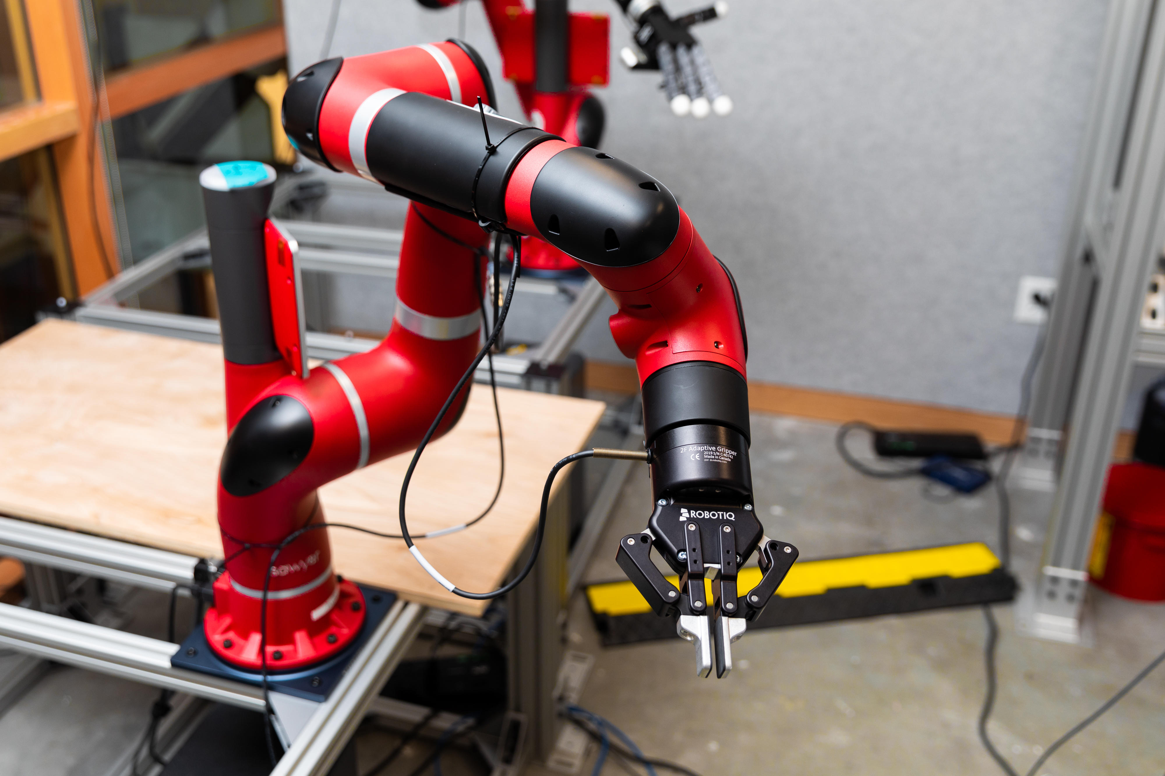 """One of Facebook's AI projects involves getting a robotic arm to use """"curiosity"""" to learn better."""