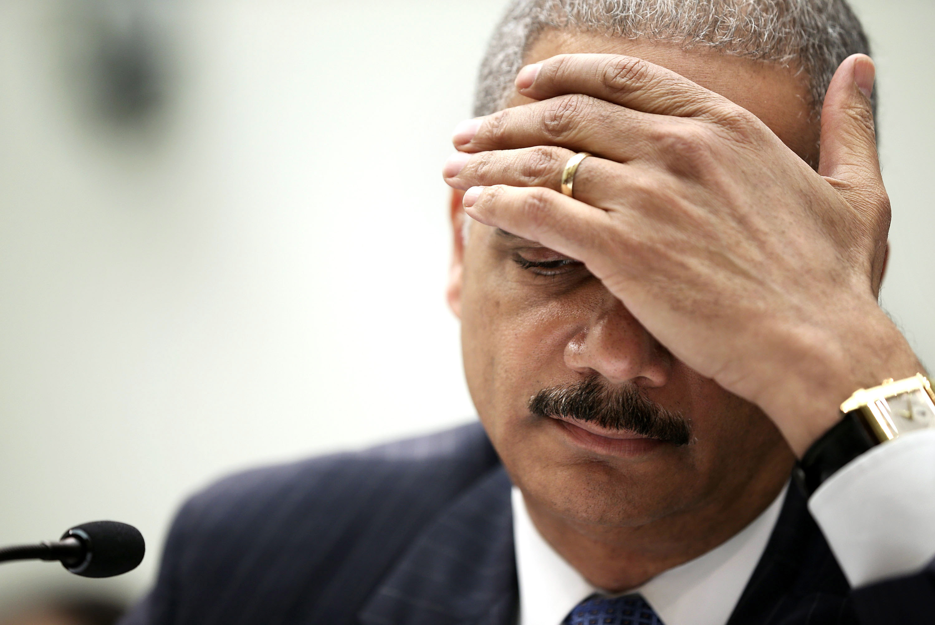 Attorney General Eric Holder, shown testifying before Congress last week, personally approved the controversial search warrant for a Fox News correspondent's e-mail.