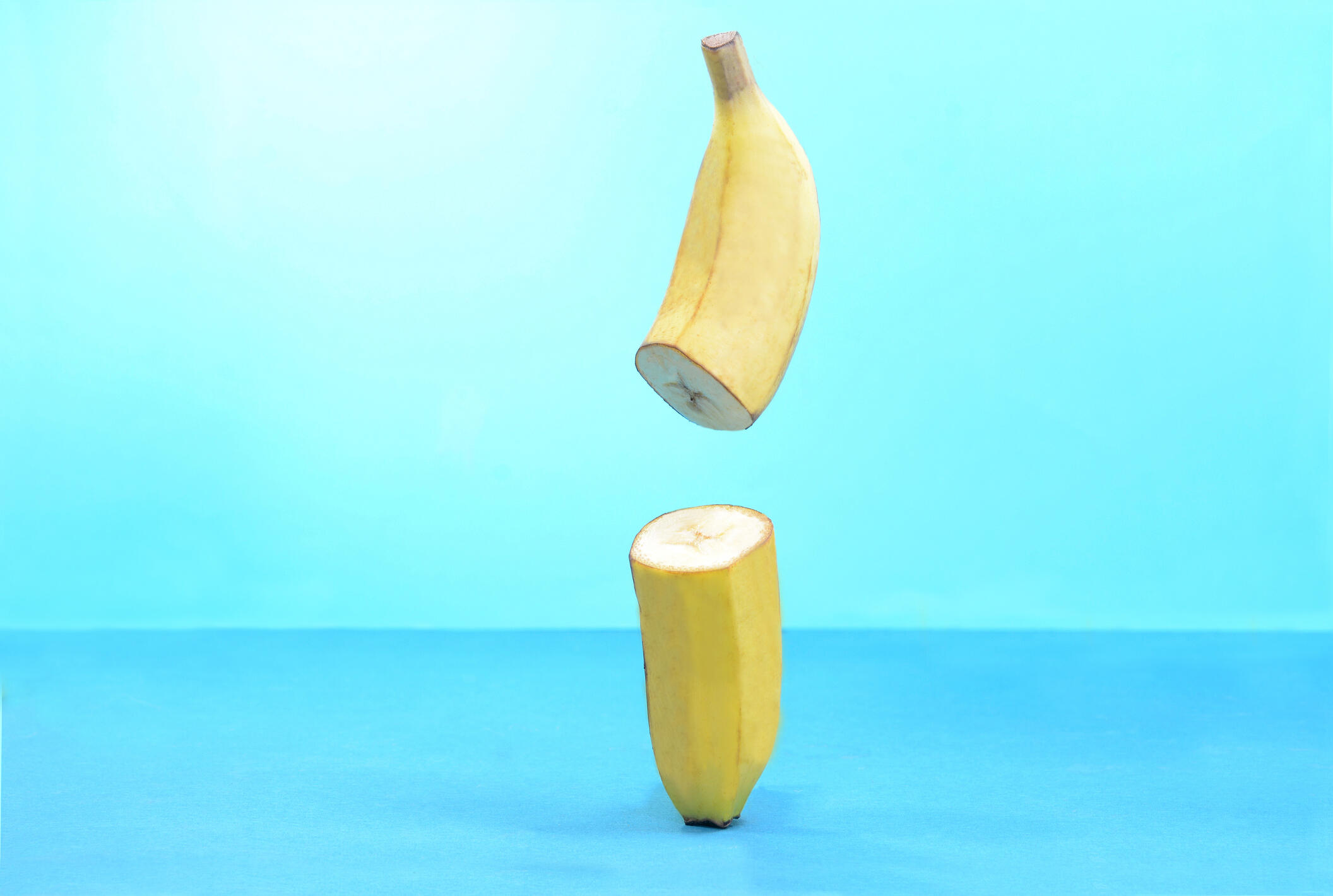 banana sliced in half on blue background