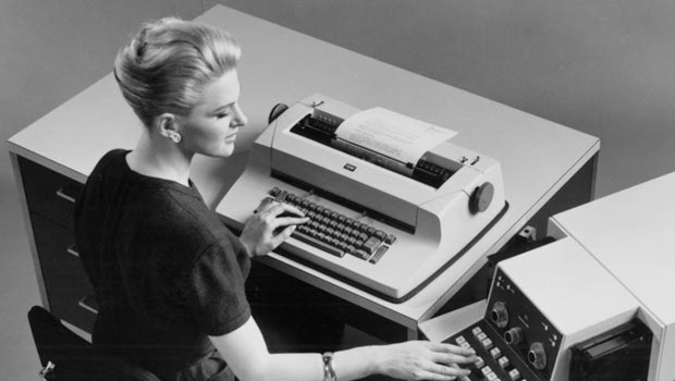The IBM Selectric typewriter being used in an office.