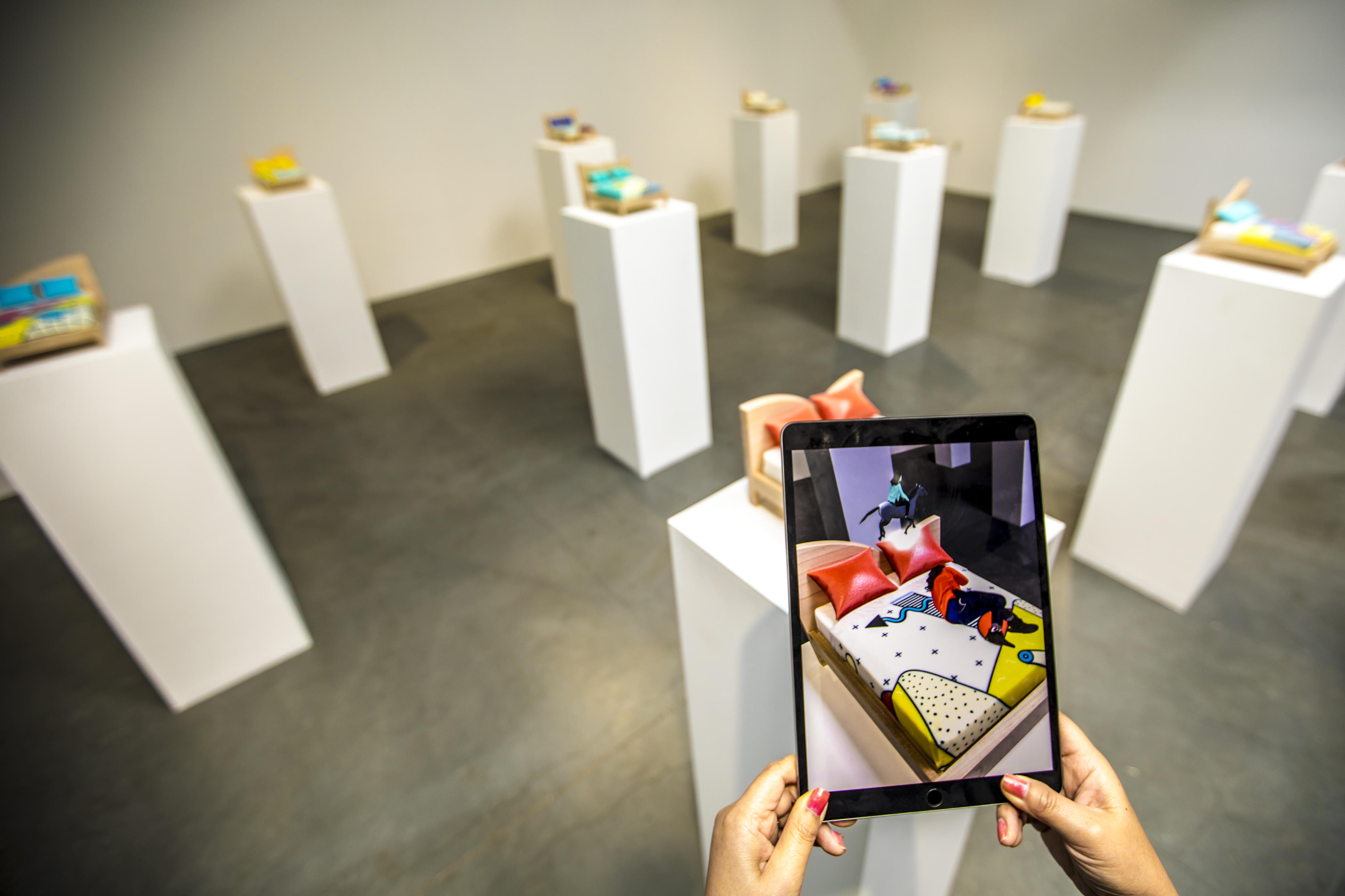 """Festival of Impossible augmented reality exhibition: """"Miniature bed sculptures act as platforms for artist Gabriel Barcia-Colombo's friends, who have been translated to avatars. The AR animations tell the story of each personality as we observe their dreams."""""""