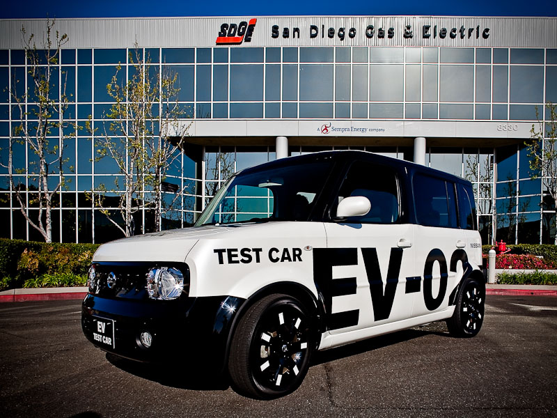 Nissan's EV in an old Cube prototype shell in front of EV partner San Diego Gas and Electric headquarters.
